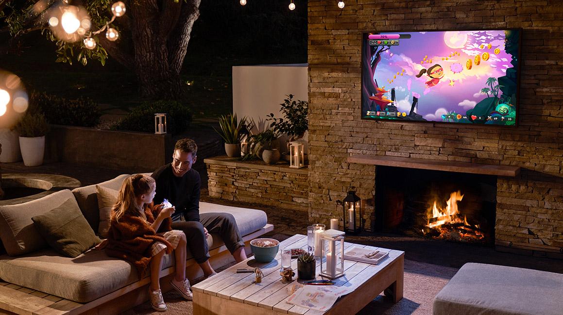 outdoor tv near fire pit