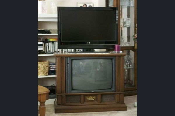 Large old tv with old flat screen on top